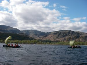 Coniston water with the Coniston fells and some canoe sailing
